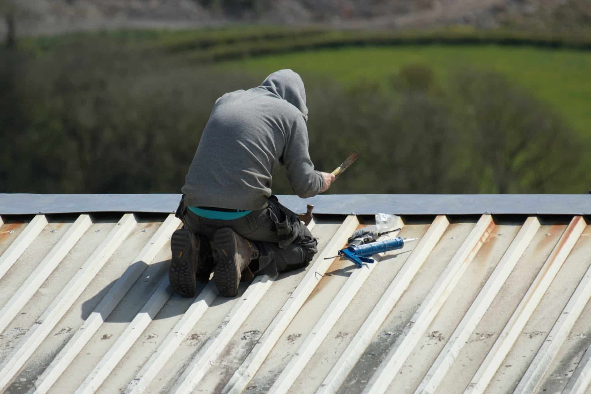 Roofer Repairing A Roof In High Point NC