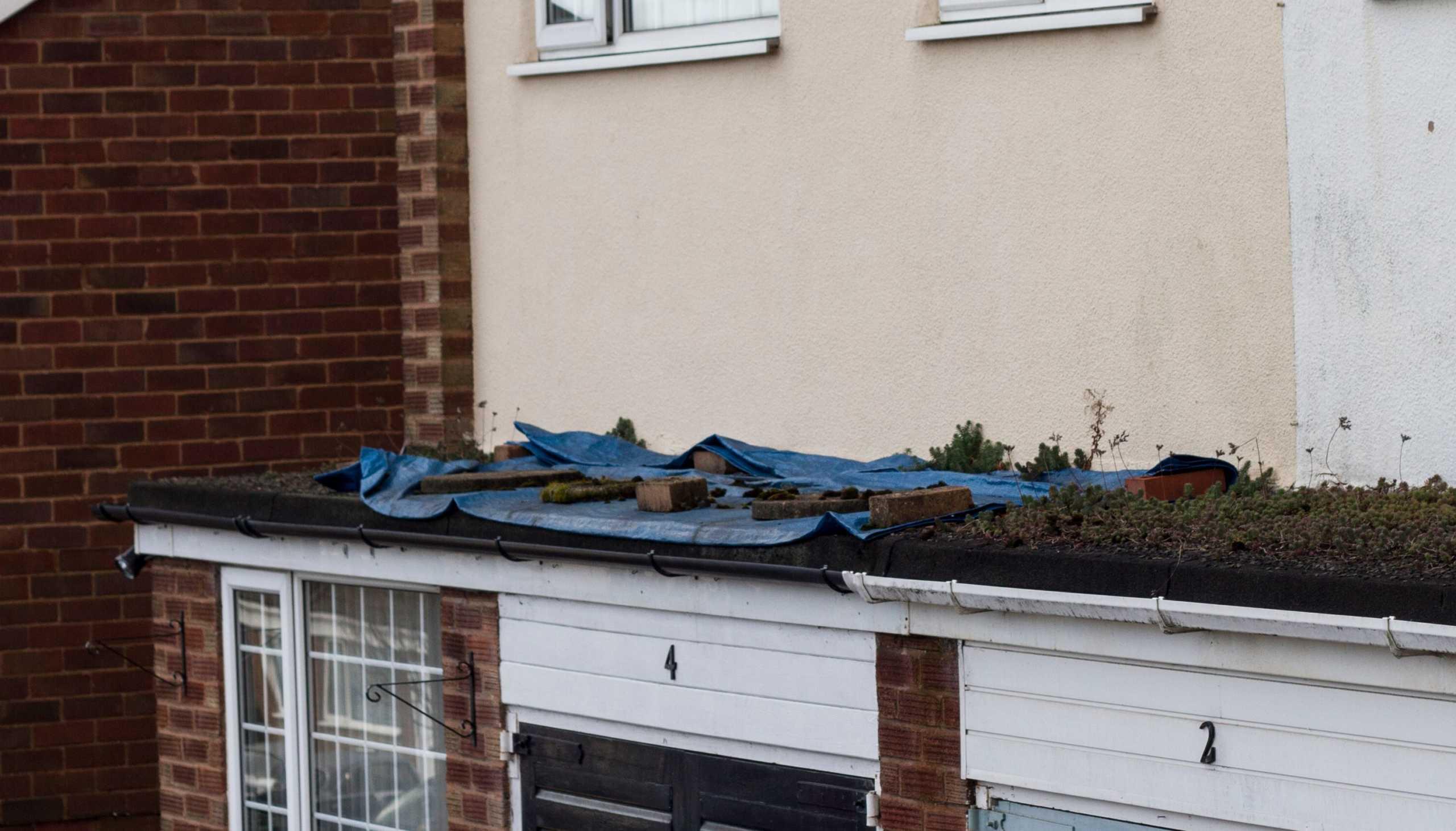 Flat roof leak repair and flat roof leak costs in Winston-Salem NC